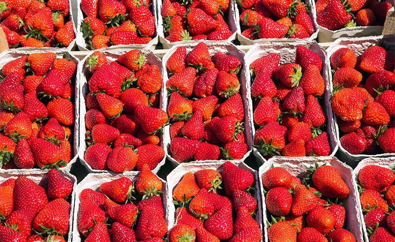 Fresh ripe strawberries for sale at a market